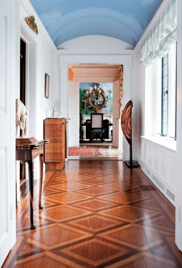 white walls, doorway details, blue ceiling, inlay wood / color conbination