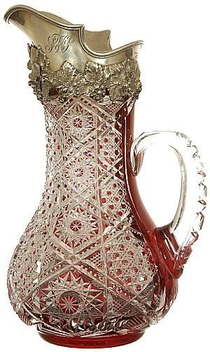 """CRANBERRY TANKARD - An exceptionally rare, dark cranberry cut to clear tankard by Dorflinger, cut in the fine #99 pattern and boasting a fine embossed vintage spout with monogram """"S.V.S."""" signed Tiffany & Company, with mark """"C"""" (for Charles C. Cook, the president of Tiffany from 1902-1907), soared to $49,000 at an American Brilliant Cut Glass multi-estate auction  (antiquetrader.com)"""