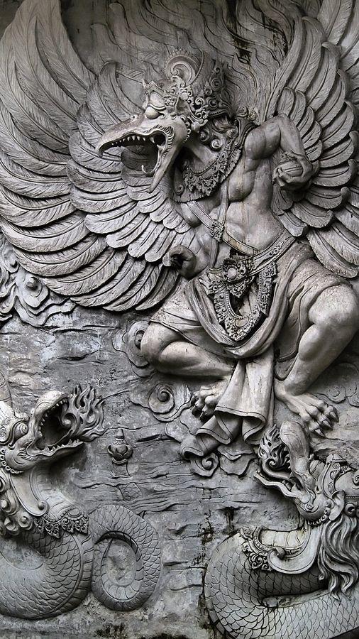 Garuda est un homme-oiseau fabuleux de la mythologie hindouiste & bouddhiste, fils de Kashyapa et de Vinatâ et frère d'Aruna, le conducteur du char du dieu Sûrya. C'est le vâhana, ou monture, du dieu Vishnu. Il est considéré comme le roi des oiseaux, ennemi naturel des nâgas. Mais Nâga et Garuda ne sont en fait que deux incarnations de Vishnu, les deux aspects de la substance divine, en qui ils se réconcilient.