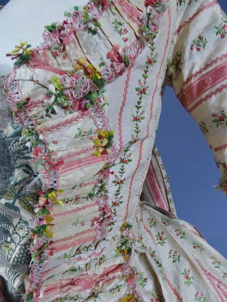 """Detail fly fringe, ccourt robe à la francaise, France ca. 1780. Very fine cream silk taffeta """"mexicaine"""" with pink stripes, embroidered with floral sprays, fabric trim, linen lining."""