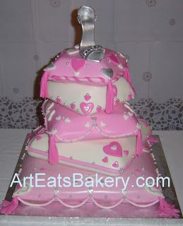 Five Tier pink and white fondant pillows custom wedding cake with hearts tassels, silver pearls and silver sugar shoe topper