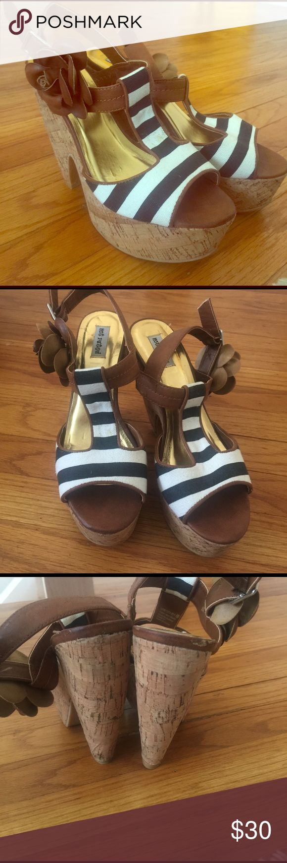 Black and white stripe cork wedges Cork wedges with black and white fabric straps. Faux leather roses by the ankle. Adjustable straps at the ankle. Open toe. Worn 1x. Excellent condition. Not Rated Shoes Sandals
