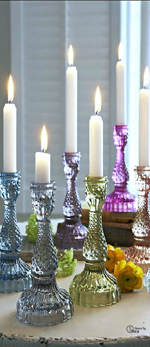 LOVE this look of identical glass candlesticks in all these pretty colors!!