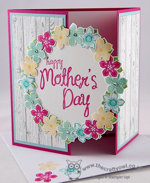 handmade card from The Crafty Owl's Blog ... Happy Mother's Day  ... wreath of stamped and punched out flowers with sentiment in the middle ... stamped white washed hardwood texture .. gatefold format .... sweet card with a country look ... Stampin'Up!