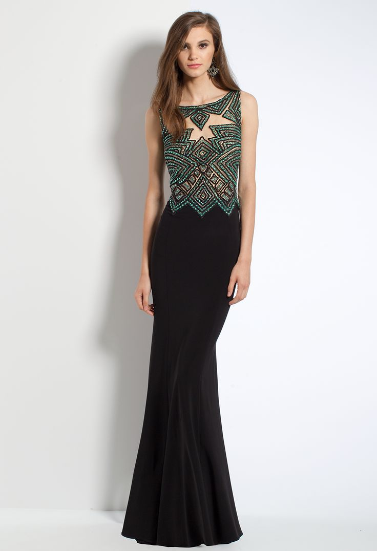 Take on the world in this gorgeous evening dress! With its Aztec pattern bodice, sheath jersey skirt, and illusion back, this beauty makes the perfect wedding guest dress. #camillelavie