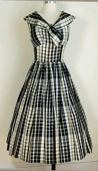 1950' Day Dress. I love the 50's dress style. its very flattering for an hour glass figure and also adds curves to the boyish shape.