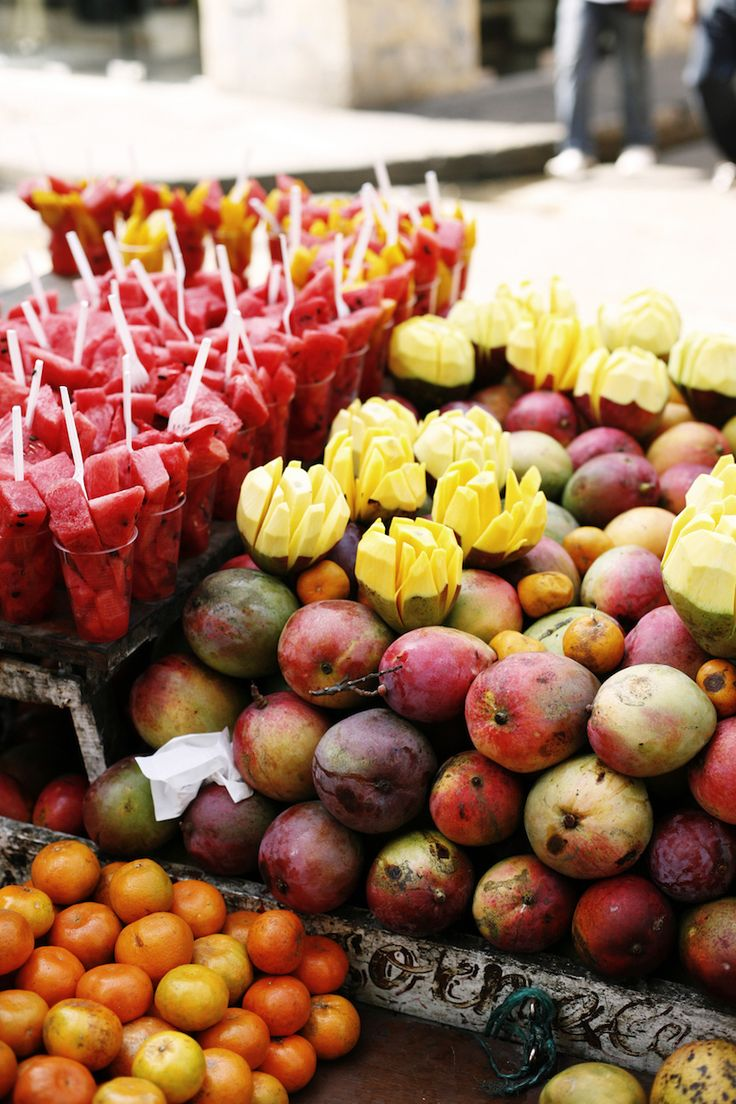 Fruit Stand With Mangos And Watermelon In A Cartagena Market