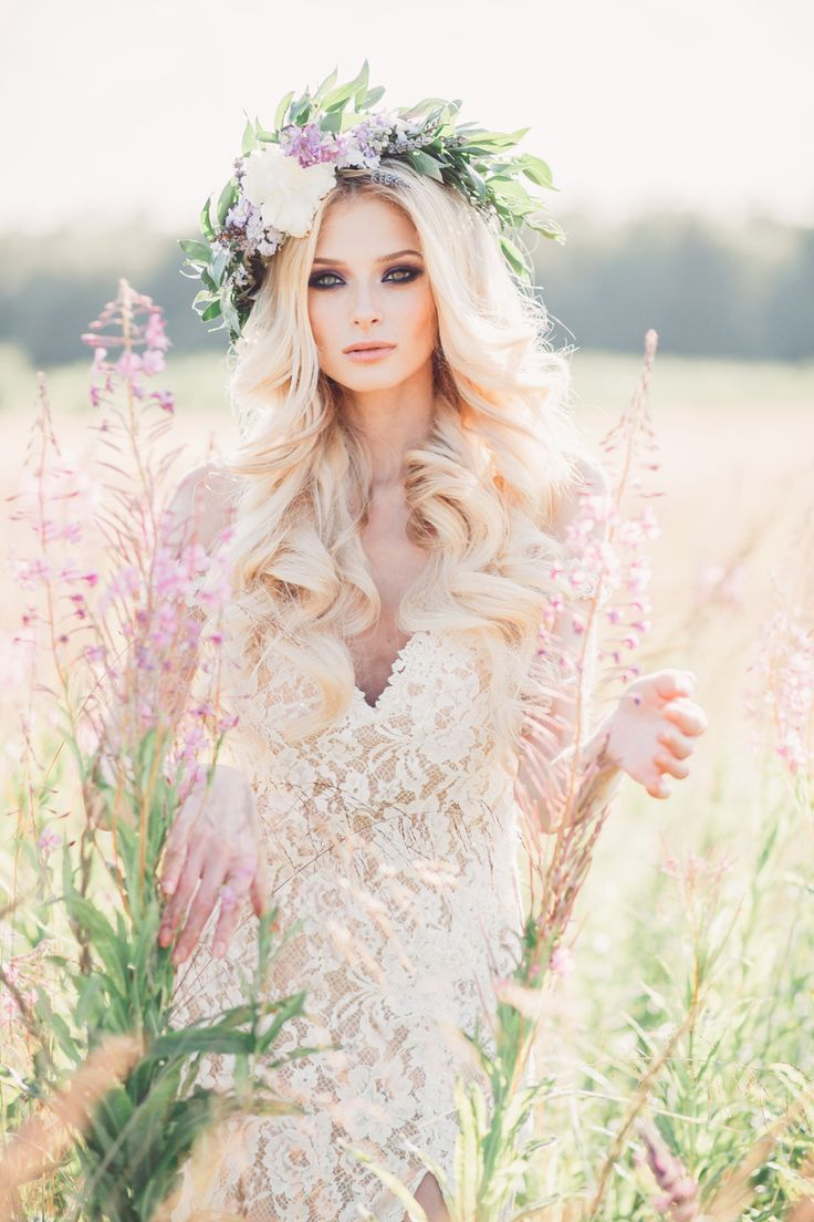 Golden field with beautiful goddess with flowers in her hair