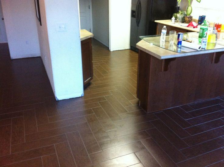 """Porcelain wood look tile installed """"herringbone"""" pattern."""