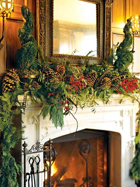 With a lush mix of holiday greens featuring fresh olives on the branch, huge pincones, pheasant feathers, and ilex berries, this mantel treatment adds a touch of nature to the room. This combination will last for two weeks -- just be sure not to let the greenery hang too close to the fireplace or it will dry out. (Photo: Photo: ; Stylist: ; Designer:)