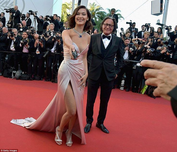 Bella Hadid and her father Mohamed Hadid on the red carpet of Cannes Film Festival's Opening Gala! The young top model wears a custom Alexandre Vauthier dress... #bellahadid #mohamedhadid #daughter #father #topmodel #celebrity #gigihadid #redcarpet #CannesFilmFestival #alexandrevauthier #custom #dress #cannes #france #s5style http://tipsrazzi.com/ipost/1516970031777391488/?code=BUNXDTnASOA