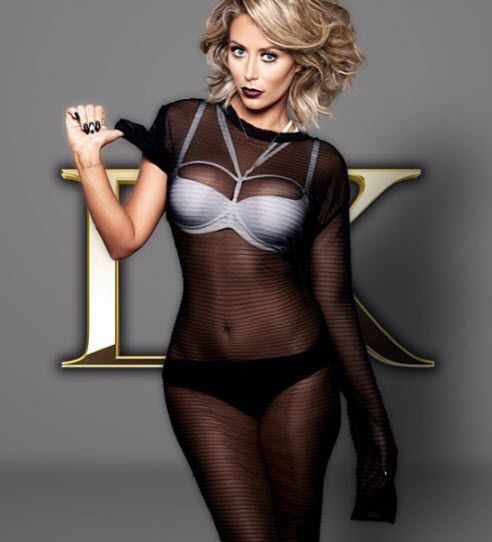 Aubrey O'Day Danity Kane photograph with gold DK logo behind her