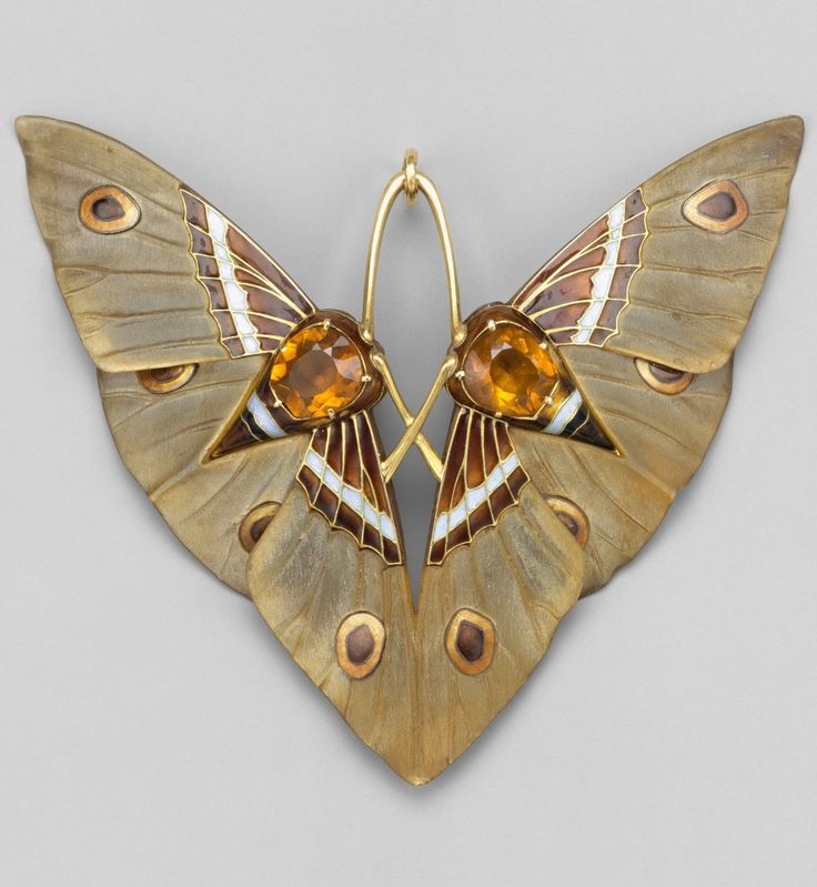 An Art Nouveau 'Moth' pendant, by Lucien Gaillard, circa 1900. Composed of gold, champlevé enamel, citrines and carved horn.