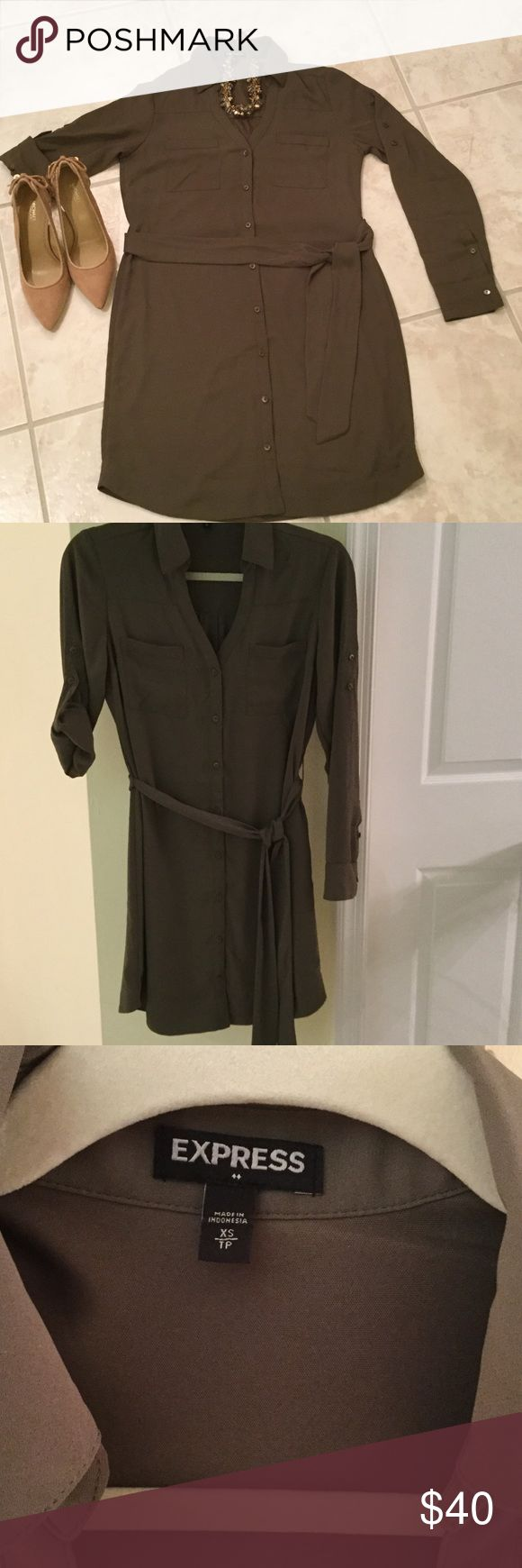 Express olive green shirt dress. Express olive green button up shirt dress with belted waist and convertible sleeves. NWOT Express Dresses Mini