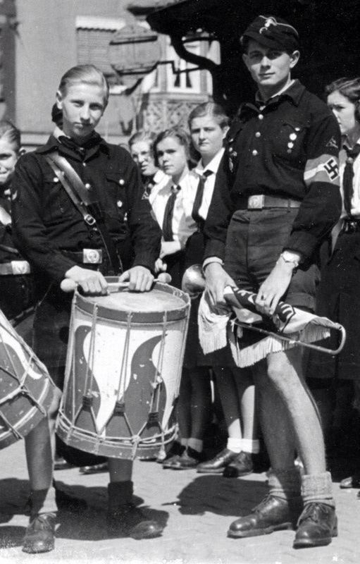 Hitler youth boys, Bund Deutscher Madel in the background.