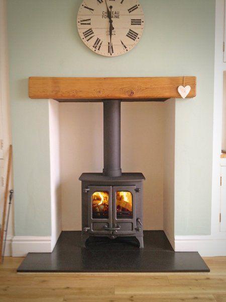 Charnwood Island 1, honed granite hearth, oak fireplace beam.jpg