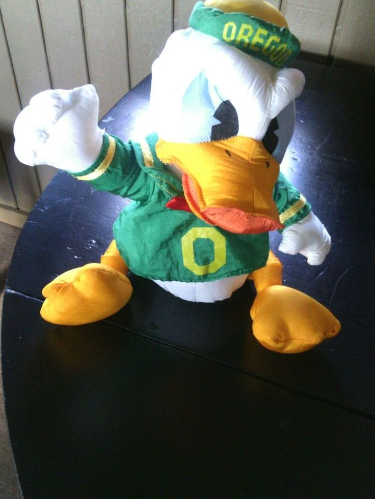 "Early 1990's ""Stuffins Manuf ."" Colorful 11"" nylon plush college mascot."