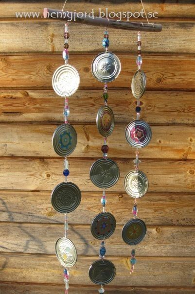 Make a wind chime from tin cans and lids.