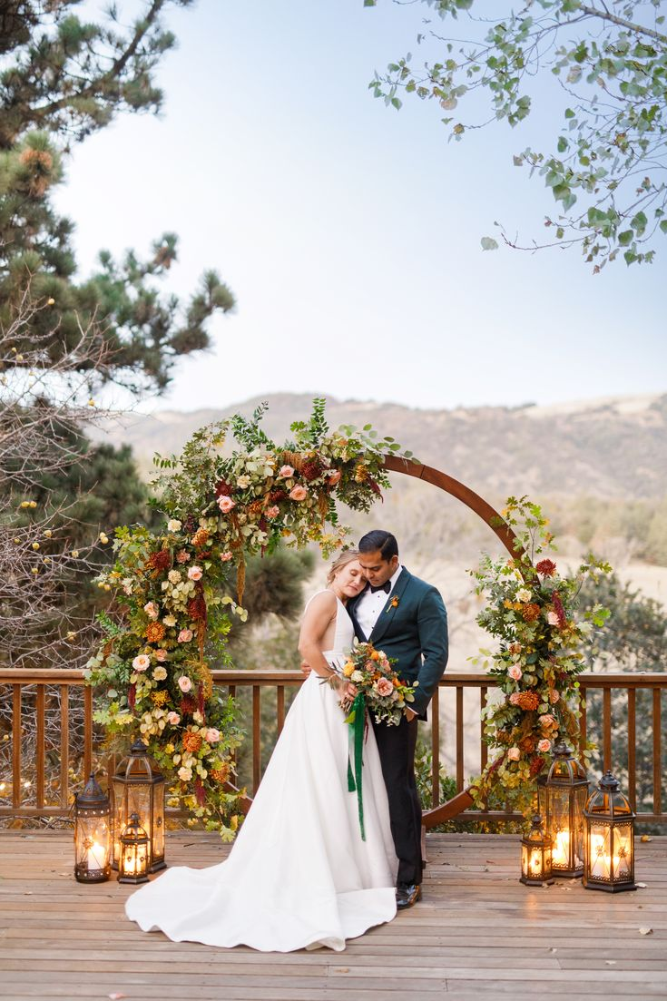 Tiny Victories | San Diego Wedding Florist and Flowers - wildflower and garden fall floral installation for circle arch moongate arch at Sacred Mountain in Julian #sandiegoflorist #weddingbouquet #fallwedding #circlearch #sandiegowedding #weddingarch #sandiegoweddingflorist #weddingflowers #wildflowerwedding #moongate #julianwedding photo by jimmy gideon photo