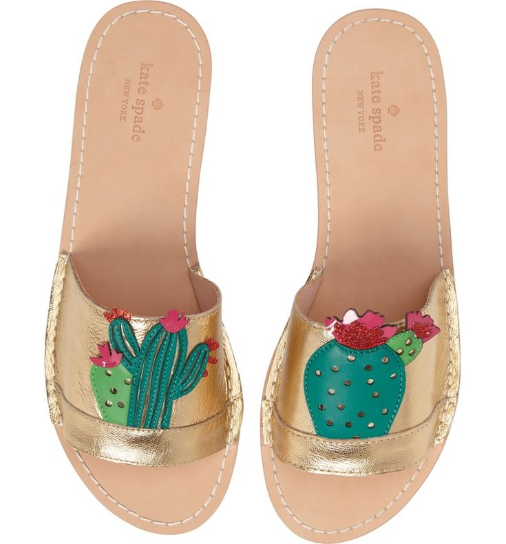 Lookin' sharp.These cactus print slide sandals are pefect for summer strolls in the sun