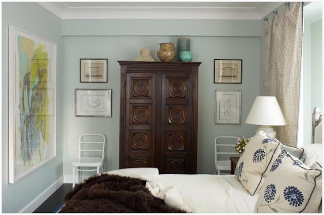 Dark wood furniture, light blue or grey walls