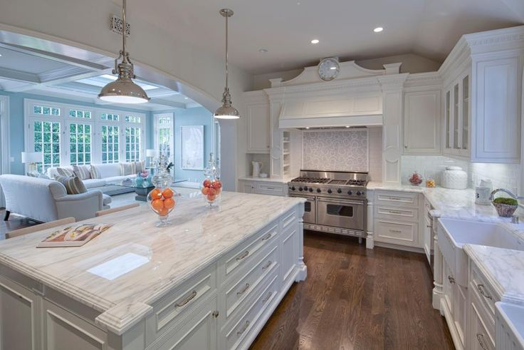 This gourmet chef's kitchen opens up to a large family room, making the space the true heart of this Bel-Air, Calif., home. Traditional cabinets are paired with beautiful marble countertops, while a large center island provides plenty of extra counter space.