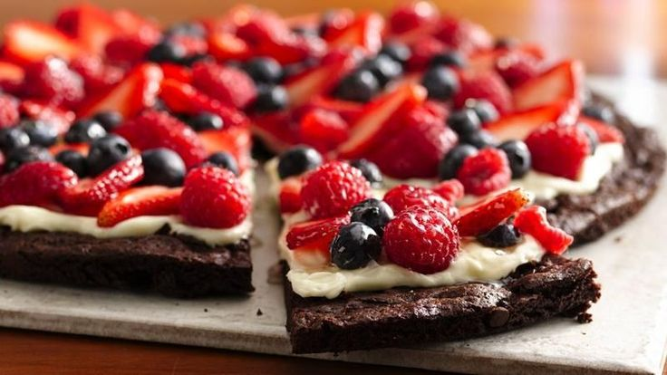 Want to wow a chocolate-craving crowd? Make a sweet dessert pizza topped with a creamy layer and tart berries.
