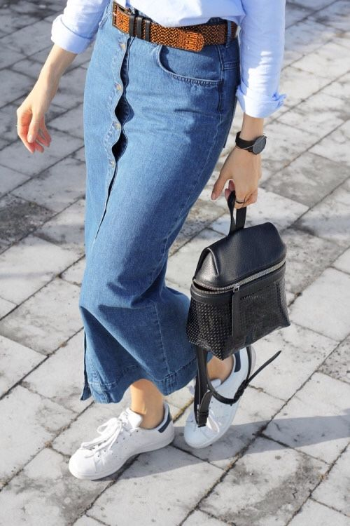 Joyce Croonen is wearing a button front long denim skirt from H&M