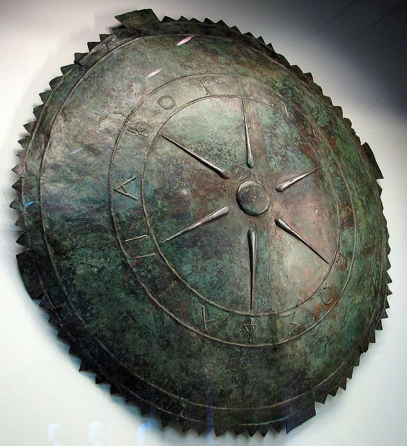 Greek, made in Pontis (Turkey), ~ 189 B.C. Bronze The star symbolizes the sun and kingship, and the inscription states that the shield was made for King Pharnakes I, who ruled Pontis from about 185 - 160 B.C. The serrated egde of the shield was once folded over to secure the thin metal to a stronger inner layer, probably made of wood or leather.