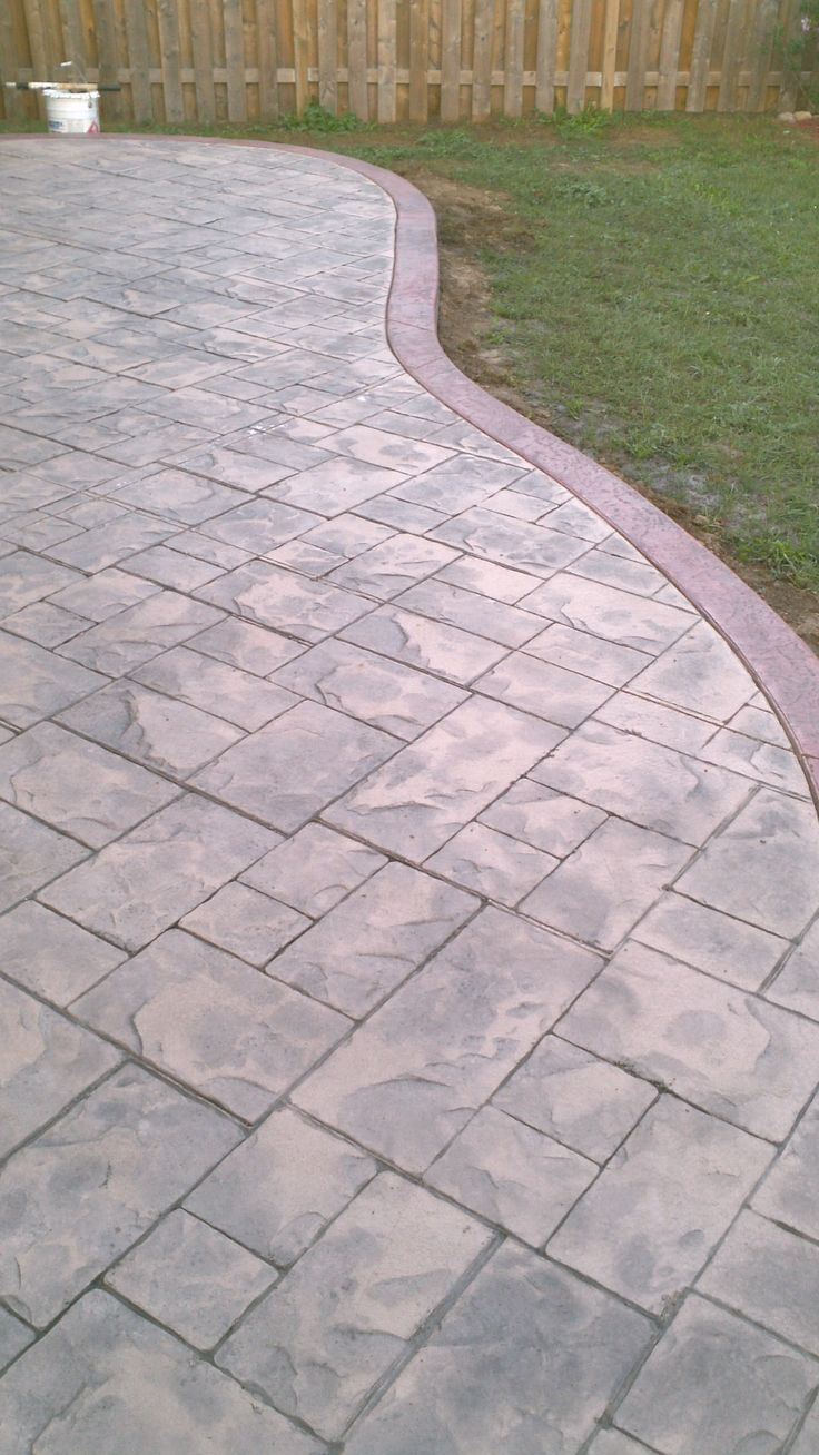 I like the birder - ashlar slate stamped concrete patio with colour hardener border.
