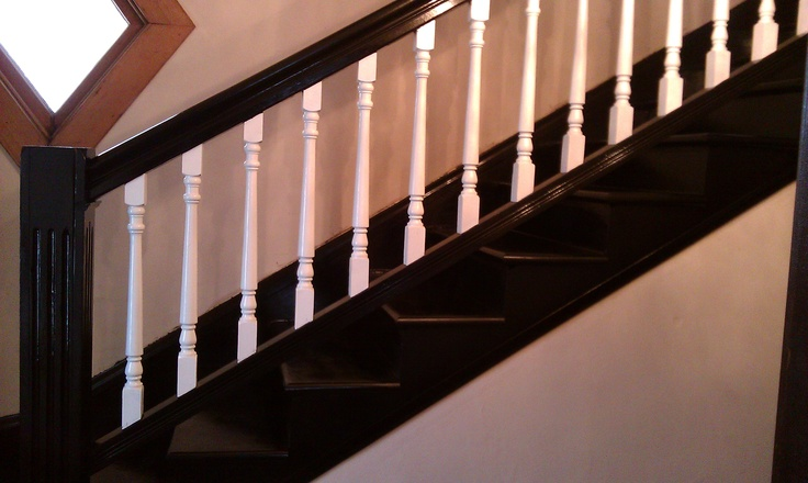 used black acrilic paint on stairs,railing, and post then painted upright rails white