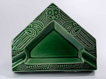 CROWN LYNN MADE IN NEW ZEALAND WHARETANA WARE NUMBER 1015 WHARE SHAPE ASHTRAY VERY EARLY PLAIN DARK GREEN GLAZE - Iridescent finish to the centre F... sold for $460.00 April 2016
