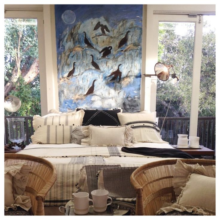 Inspired by South African artist Karen Bezuidenhout's painting featuring cormorants, a fish-pursuing diving bird which is most abundant on the West Coast of Africa, a bedroom sanctuary. Layered textures and patterns of cream and black linens on the bed, flanked with chairs from Malawi.