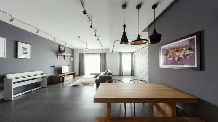 Apartment: Interesting ML Apartment in Hanoi, Vietnam Designed by Le Studio, ML Apartment Living Room View from Dining Area showing Suede Sofa and TV over Wooden Bench and Wall Shelf also Huge Glass Windows and Gray Window Curtains and Industrial Ceiling Lamps