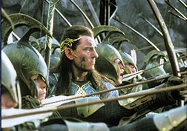 Gil-galad at the Last Alliance of Elves and Men. He died in this battle, as did Elendil. Gil-Galad was a Noldor elf, and was the last High King of the Noldor. Gil-Galad was a receiver of one of the three rings given to the elves, along with his sister, Galadriel. (I actually never noticed him in this scene.)