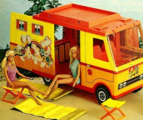 I had this exact Barbie Camper and my Cousin Michelle had the Town House. The camper had a pop-out tent on the other side and a table that folded down on the back. It came with two vinyl sleeping bags and two folding chairs. I sort of remember mine having a plastic molded campfire with a circle of rocks, but I can't find any pictures of that. Perhaps I took the campfire from another set.