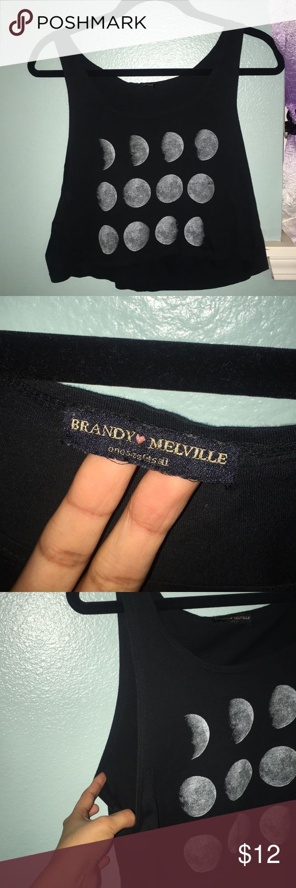 Brandy Melville Tank Top From Brandy Melville shirt. Only located in few states. (Check them out on their website). The shirt is low cut on the underarms and it is a semi-crop top. Brandy Melville clothing materials are super soft and comfortable (: Brandy Melville Tops Tank Tops
