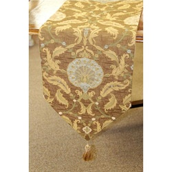 Woven by master weavers, this table runner features hand-tied tassels and fully lined. A lovely gold and paprika transitional design finishes this table runner. ~ $69.29