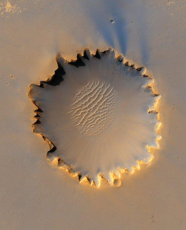 Jervis T.C.H.: Mars' Victoria Crater at Meridiani Planum is seen in this image taken by NASA's High Resolution Imaging Science Experiment (HiRISE) camera