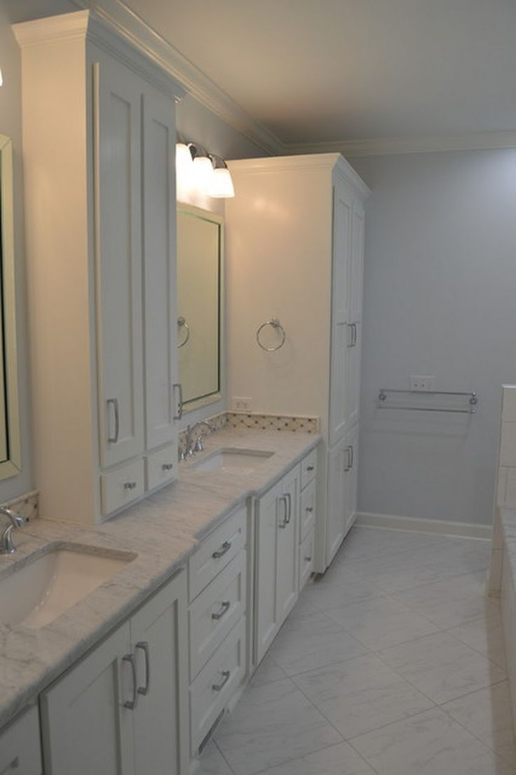 White Carrara Bathroom Remodel With Cabinets And Silver Fixtures In Columbia Sc
