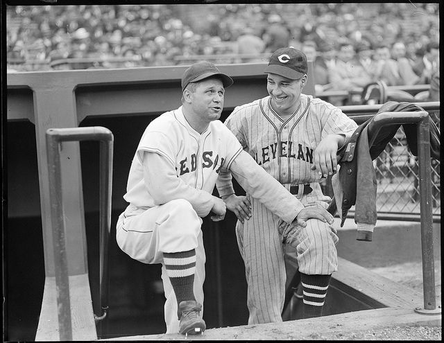 1937 -  Boston Red Sox first baseman Jimmie Foxx and Cleveland Indians pitcher Bob Feller.