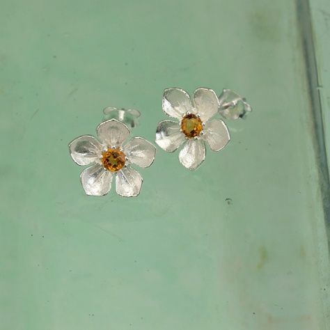 """Sterling Silver and Citrine Citrine Posy Earrings £29.00 Feel a warm glow with these citrine and sterling silver flower stud earrings All of our silver jewellery comes beautifully packaged in our new Christin Ranger branded boxes. Look for us in the September issue of """"Good Housekeeping""""."""