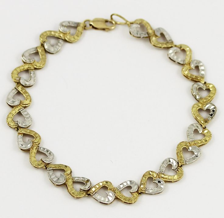 One lovely heart-patterned yellow and white heart bracelet. Perfect for the one who has your heart.