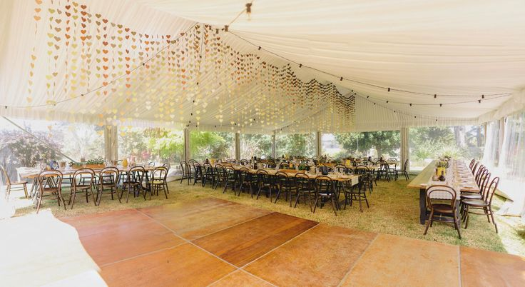 silk lining, festoon lighting, 10m marquee structure, dance floor, vintage timber tables, bentwood chairs