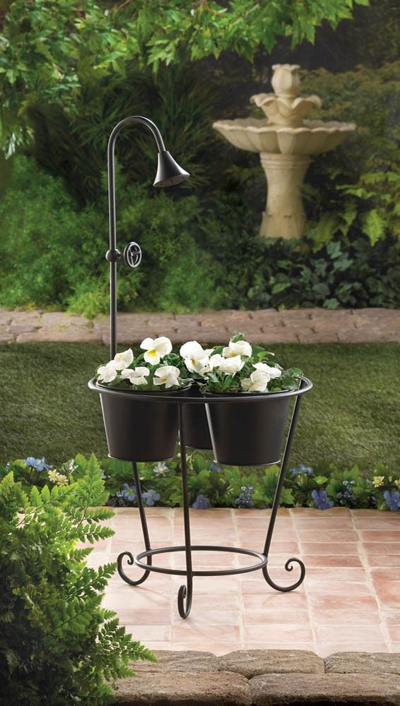 15 best images about wholesale garden plant stands home for Outdoor decorating with potted plants