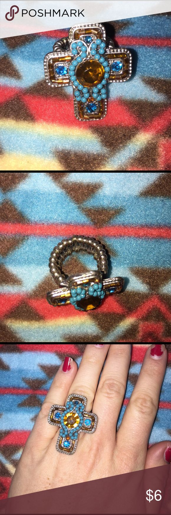 Beautiful Brown/Blue Cross Ring Beautiful Brown/Blue Cross Ring on a one size fits all stretch ring. Turquoise blue and amber brown coloring. Jewelry Rings
