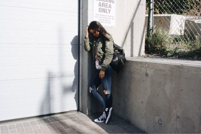 Hi-Top Converse, Free People Busted Knee Skinny, Aritzia Bomber, Fawn Design Diaper Bag.