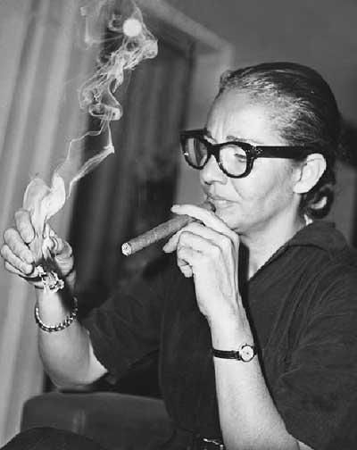 "This is a VERY young Chavela Vargas (born 1919). When you hear her voice, there is no mistaking it...gravel, smoke and hard liquor in every note. Wikipedia's summary of her early life: ""For many years she sang on the streets but in her thirties she became a professional singer. In her youth, she dressed as a man, smoked cigars, drank heavily, carried a gun and was known for her characteristic red jorongo [poncho], which she still dons in performances."""