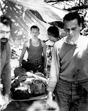 Hsamshingyang, Burma _ Early April 1944 Marauder injured in combat with Japanese brought into airstrip for evacuation after treatment by battalion medics.