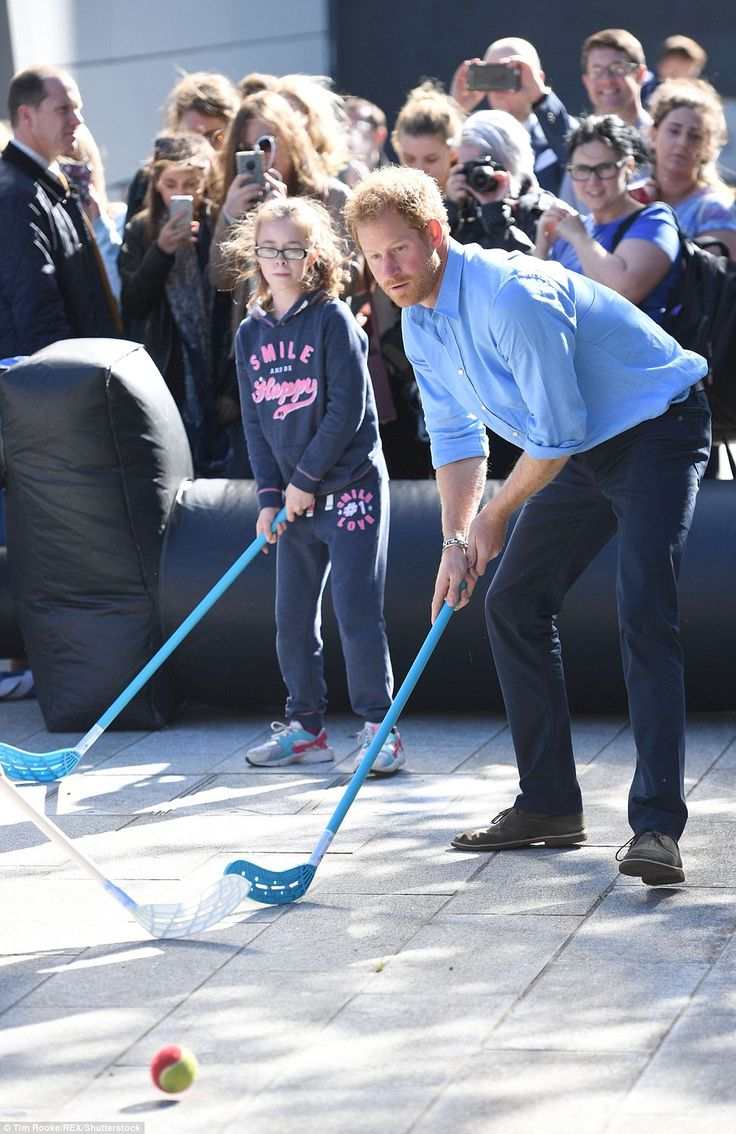 A serious-looking Prince Harry eyes up the ball as he focuses his attention on a game of h...